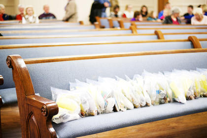 "The front pew of Bardstown Baptist Church was full of ""Blessings in a Bag"" filled by members of the church during their recent Camping for a Cause event. Each bag contains a bottle of water, an energy bar, a packet of cheese and crackers, a pair of socks and a special blessing message. The bags were distributed to the members and local law enforcement to be handed out in the event they should encounter a homeless person in need. For more information about the bags, call the church at 348-3866."