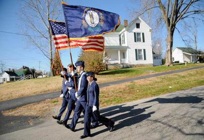 Members of the Civil Air Patrol Ghost Squadron, Matthew Kliessendorf, Gennasea Fain, Josh Morgan and Amy Lanie, carry the colors to the Veteran's Day ceremony at Bloomfield Memorial Park.