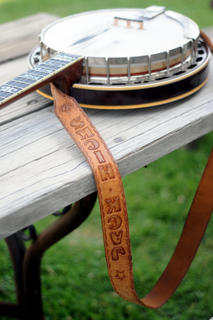A banjo belonging to Jack Hicks from Jerry Butler and The Blu-Jays rests on a table at The Bardstown Bluegrass Festival at White Acres Campground Saturday.