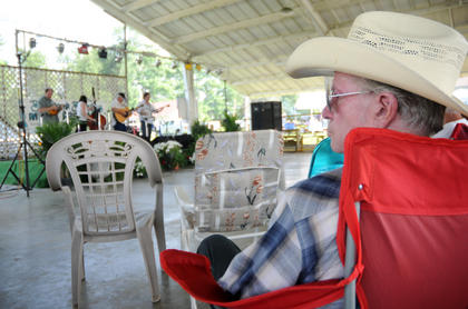 """Radio broadcaster Berk Bryant a.k.a., """"The Country Gentleman,"""" watches Jerry Butler and The Blu-Jays perform at The Bardstown Bluegrass Festival Saturday./JAMES CALVERT"""