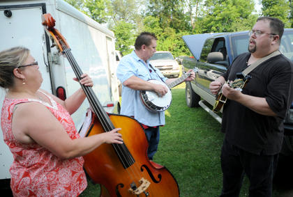 """Amy Prather, Kent Hurley and Glenn Hurley of """"Hurley Ridge"""" practice before taking the stage at The Bardstown Bluegrass Festival Saturday."""