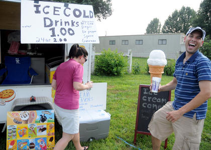 Misty McCubbins and Aaron McCubbins sell cold drinks and ice cream at The Bardsrtown Bluegrass Festival Saturday. Temperatures exceeded 90 degrees on Saturday. Business was good Saturday, Aaron McCubbins stated.