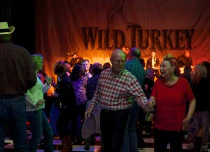 A couple take to the dance floor at the Boots and Bourbon event Thursday night of the 2014 Kentucky Bourbon Festival.