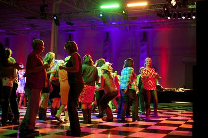 Guests take to the dance floor at the Boots and Bourbon event Thursday night of the 2014 Kentucky Bourbon Festival.