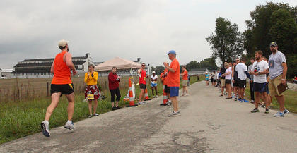 A runner approaches the Deatsville exchange zone Friday as the first leg of the Bourbon Chase is passed on to the second.