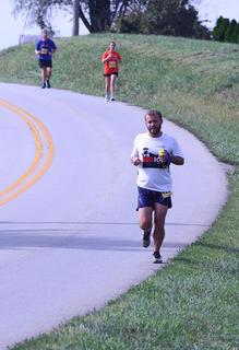 Damon Barnes, who has family in New Haven, catches a downhill break while running on Templin Avenue during this weekend's Bourbon Chase.