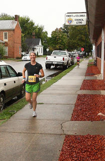 Casey Kaucher runs through downtown Bardstown during the Bourbon Chase.