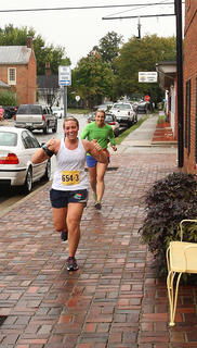 Runners were enthusiastic while rolling through downtown Bardstown during the Bourbon Chase Friday, despite rainy conditions during the day.