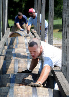 David Hoffman arranges barrels weighing 530 pounds in a row near Heaven Hill Distillery.