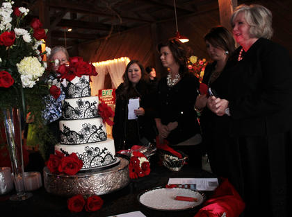 Guests admire samplings at the Cakes by Jeanne table at the annual Kentucky Standard Bridal Fair Sunday.
