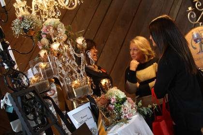 Attendees at the Kentucky Standard Bridal Show browse items on display.