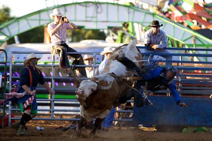 Travis Leistner is thrown from a bull during the rodeo Tuesday night at the Nelson County Fair.