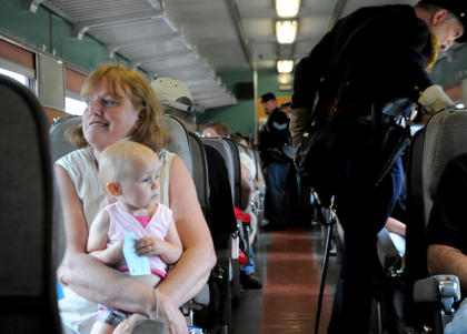 Diane Robinson, Shelbyville, holds her grandaughter Kate Lyn Robinson on a passenger train from the Kentucky Railway Museum.