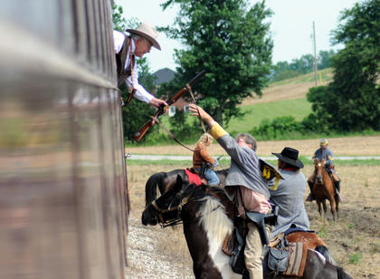 Confederate soldiers prepare to board a passenger car during a reinactment of a robbery near The Kentucky Railway Museum.