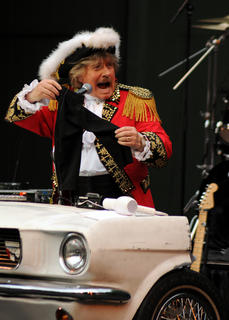 Paul Revere and the Raiders play a set for fans at the J. Dan Talbott Amphitheater Monday. Paul Revere plays a keyboard made from the hood of a Ford Mustang.