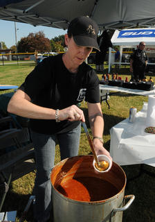 Kathy Kelley pours a cup of chili made by the owners of the Old Talbot Tavern at the Bardstown-Nelson County Chili cook-off Saturday. The chili won first place in the cook-off. Kelley's husband, John, co-owns the Old Talbott Tavern.