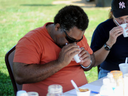 Pat Douglas, Bardstown Rotary Club, smells a cup of chili while judging the first annual Bardstown-Nelson County Chili Cook-Off Saturday.