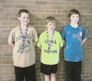 The Cobra Wrestling club competed at the Fern Creek tournament last month, with Dakota Curtsinger, 8, Grant Amshoff, 9, and Keldon Tilley, 11, each placing.