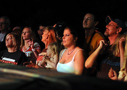 Fans watch the Kentucky Headhunters play Saturday at the Kentucky Bourbon Festival concert stage.