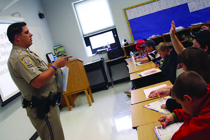Nelson County School Resource Officer Joedy Gilliland teaches Foster Heights Elementary students about the dangerous effects of drugs and alcohol during a Drug Abuse Resistence Education, or DARE, class Tuesday.