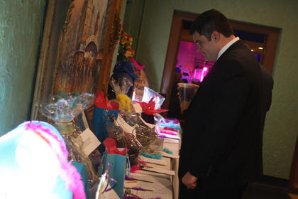 Jonathan Heaton browses various items on display.