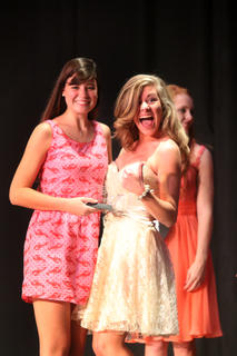 Maggie Finn (left) and Aria Mathis, pose for a photo after Mathis was announced as third runner-up for the Distinguished Young Woman program.