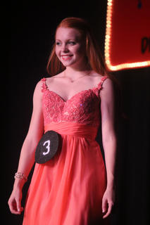 TNHS student Blaire Bischoff poses for the judges on stage during the Distinguished Young Woman program. Bischoff won the Spirit Award.