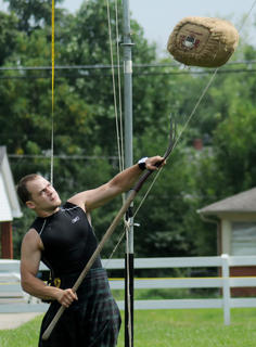 Chris Branham, Indiana, competes in the sheaf toss at the Wickland Highland Games and Celtic Festival Saturday. The object of the game is to throw a burlap bag over a 20-foot-tall pole.