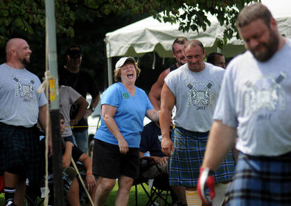 Kerry Overfelt, Donna McNeilly and Brian King laugh at a competitor who fell short of tossing a burlap sack over a 30-foot-tall pole at the Wickland Highland Games and Celtic Festival Saturday.