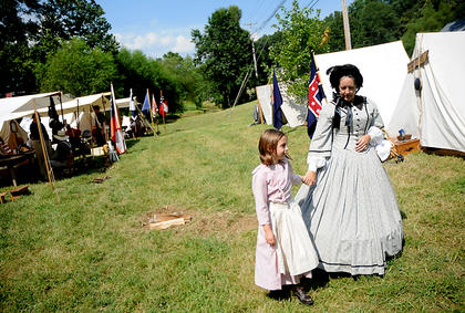 Emily Burchett Munfordville, walks through a reconstructed Civil War battlefield camp with Debbie Fields, Munfordville.