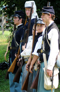 Young union and confederate recruits stand at attention during a Civil War reenactment at the Old Bardstown Village Saturday.