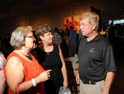 State Representative Linda Belcher, Bullitt County and LouAnn Moore, president of the Bullitt County Chamber of Commerce, talk to State Representative David Floyd at The Kentucky Bourbon All-Star Sampler at the Guthrie Opportunity Center Wednesday.