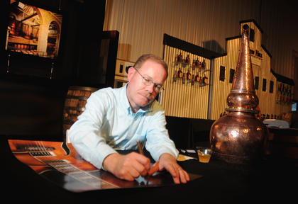 Chris Morris, Master Distiller at Woodford Distillery, signed a poster at the Kentucky Bourbon All-Star Sampler at the Guthrie Opportunity Center Wednesday.