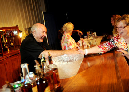 Jimmy Russell, Master Distiller at Wild Turkey Distillery, shakes hands with Doris Mattingly, of Kentucky Cooperage. Six master distillers met with guests and signed bottles at The Kentucky Bourbon All-Star Sampler at the Guthrie Opportunity Center Wednesday.