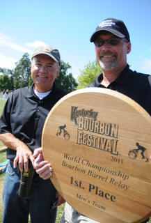 Erskine Keeling and Jody Filiatreau pose with the award that was given to the Heaven Hill Dsitillery Men's Team, who won the World Championship Bourbon Barrel Relay Saturday.