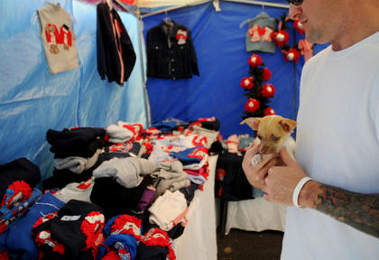 Paul Thompson, Bardstown, carries his Chihuahua, Mojo at the Bardstown Arts Crafts and Antiques Fair Saturday.