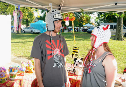 Michael Lefaivre and Tanya Lefaivre, New Haven, sell hats they made at their booth at the Bardstown Arts, Crafts and Antiques Fair Saturday.