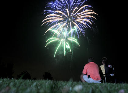 Gary Albertson and Audrey Albertson, Bardstown, watch the firework show from My Old Kentucky Home Golf Course Saturday.