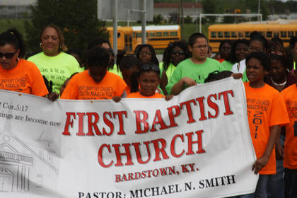 Members of First Baptist Church of Bardstown carry their banner during the Youth March for Christ held Saturday, April 30. Over 3000 youth and adults participated in the weekend event which included gospel explosion, youth classes and activities. Awards and scholarships were given to the youth.