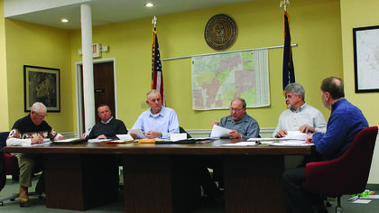 Members of the Nelson County Fiscal Court discuss the county's bills at their first meeting of the new year Tuesday. From left to right are Magistrates Jerry Hahn, Jeff Lear, Bernard Ice, Sam Hutchins and Keith Metcalfe, and County Judge-Executive Dean Watts.