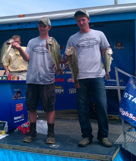 Hunter Smith, left, and Anthony Wilkerson show off some of the big lunkers they caught during the Kentucky State High School Bass Fishing Tournament at Kentucky Lake last month.