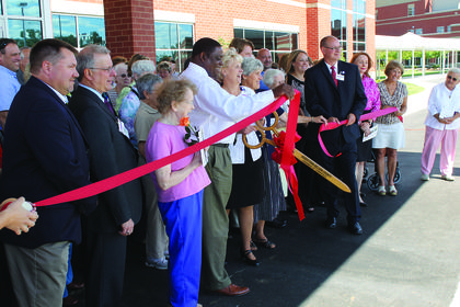 Bardstown Mayor Bill Sheckles, Flaget Memorial Hospital President Sue Downs, Sister Susan Gatz, president of the Sisters of Charity of Nazareth, and many other local dignitaries took part in a ribbon cutting ceremony Friday for the dedication of the SCN Medical Office Building next to the hospital.