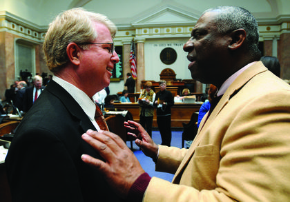 Rep. Derrick Graham, D-Frankfort, right, confers with Rep. David Floyd, R-Bardstown, during a recess period in the Kentucky House of Representatives.