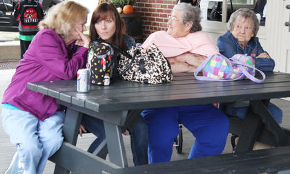 Betty Walls, Angela Walls, Kathy Walls and Lois Vanviver listen to some karoake music during the festival.