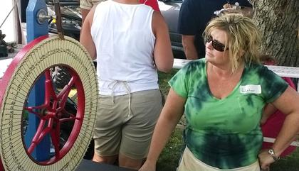 Brandie Morrison spins the wheel Sunday at the stuffed animal booth at the Howardstown Picnic.
