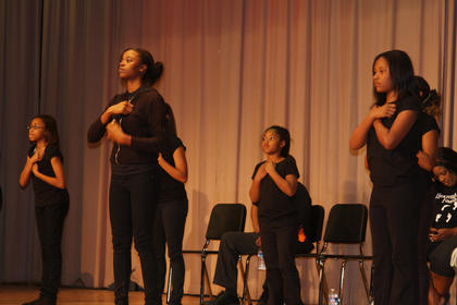 Youth of 11th Street Baptist Church of Bowling Green perform a dynamic liturgical dance during the Gospel Explosion.