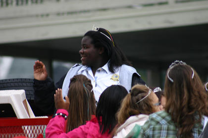 Homecoming pageant Queen Aleah Graham waves during the parade.