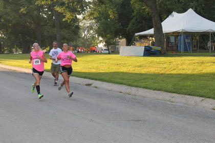 Mariam Haydon and Sydney Disponette of Bardstown High School's cross country and soccer teams, finish the Run for the Health of It 5K Saturday at Spalding Hall.