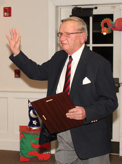 Haydon Spalding waves to the audience after receiving his chamber Hall of Fame award Friday night.
