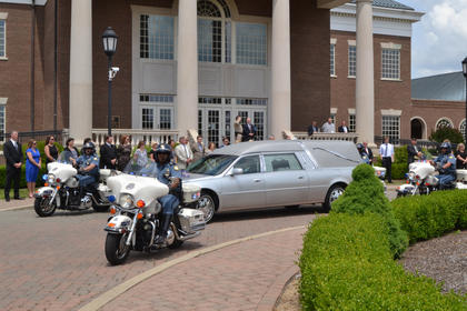 The hearse carrying slain Bardstown Police Officer Jason Ellis is escorted past the Nelson County Justice Center Thursday.